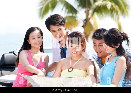 Friends Looking at a Map - Stock Photo
