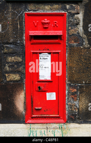 Traditional British red pillar post box in the university town of Cambridge, VR - Stock Photo