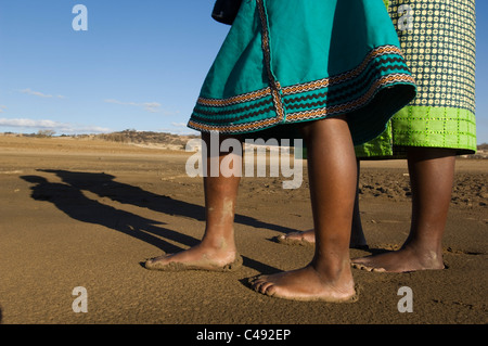 Mother and child walking barefoot on the lake shore, KwaZulu-Natal, South Africa - Stock Photo