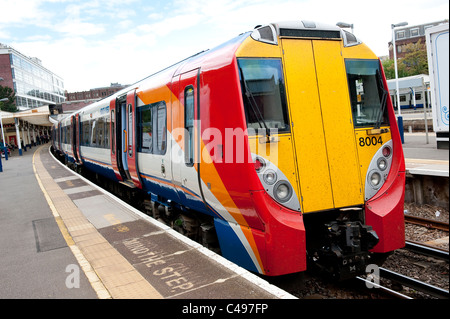 Class 458 juniper passenger train in South West Trains livery waiting at Richmond station platform. - Stock Photo