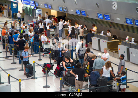 Departure hall of the Ministro Pistarini International Airport in Buenos Aires, Argentina. - Stock Photo