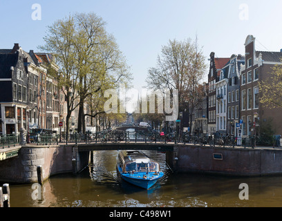 Sightseeing cruise on the Leidsegracht canal near the crossing with the Prinsengracht, Grachtengordel, Amsterdam, - Stock Photo