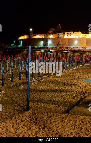 Night view of Termoli beach with old town and lighthouse in the background - Stock Photo