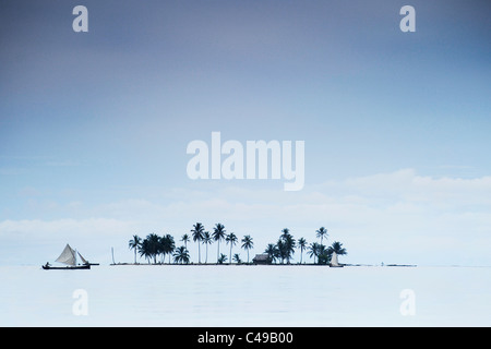 View of boat sailing past distant island in San Blas archipelago of coast of Panama, Central America - Stock Photo