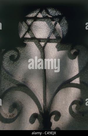 The shadow of the Star of David on a wall in the Hungarian Great Synagogue - Stock Photo