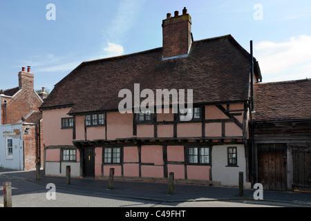 Old House dwelling Titchfield Hampshire England UK High Street timber frame wood wooden pink weathered oak garage - Stock Photo