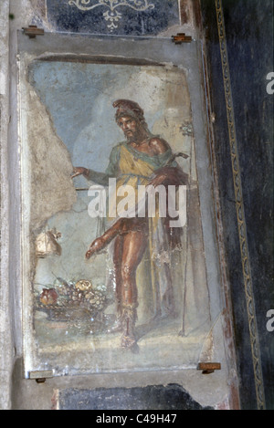 Photograph of a painting of a Roman soldier on a wall in the ruins of the ancient Roman city of Pompeii - Stock Photo