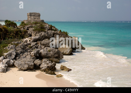 Temple of the Wind God and beach at the Mayan ruins of Tulum on the Riviera Maya, Quintana Roo, Mexico - Stock Photo
