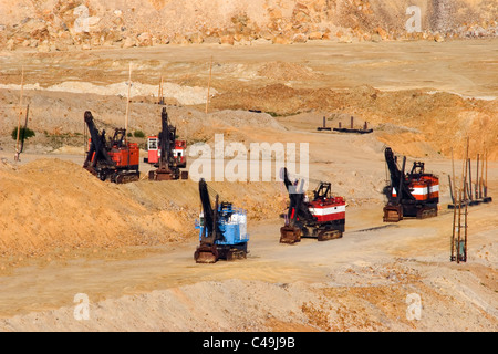 A series of excavators at a molybdenum mine - Stock Photo