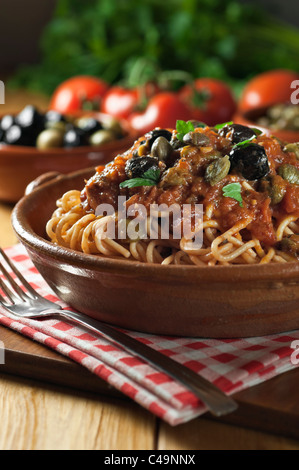 Spaghetti alla puttanesca Italian food - Stock Photo