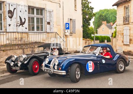 Replica 1930s Jaguar SS100 and Jaguar XK140 Roadster classic cars - France. - Stock Photo