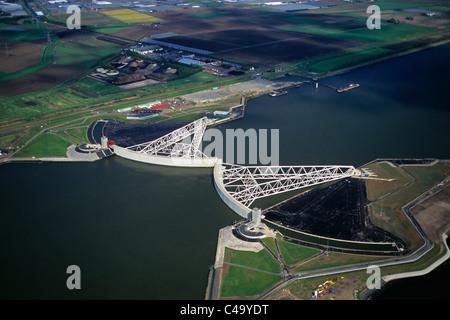 Netherlands, Rotterdam, Closed Storm Surge Barrier called Maeslant Barrier or Maeslantkering. Part of the Delta - Stock Photo