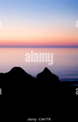 Sunset over Thornwick Nab Flamborough Head East Riding of Yorkshire England - Stock Photo