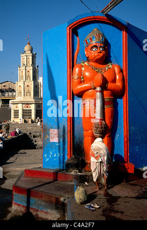 Photograph of a statue of an Indian god in a shrine in the Indian city of Nasik - Stock Photo