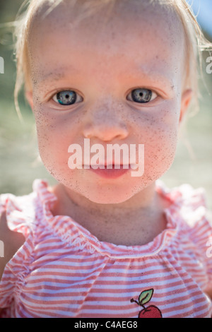 Head and Shoulders Portrait of 1 Year Old Girl - Stock Photo