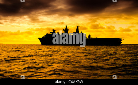 The Royal Navy 'Albion' class, assault ship HMS Bulwark at sunrise. - Stock Photo