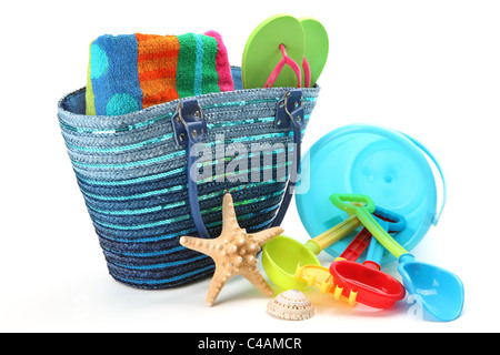 Beach bag and toys,isolated on white background. - Stock Photo