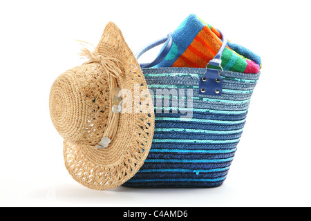 Beach bag with straw hat and towel,isolated on white background. - Stock Photo