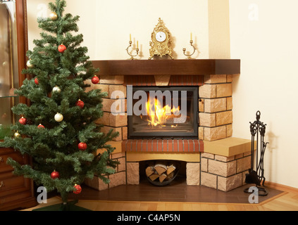 Image of house room with Christmas tree and fireplace in it - Stock Photo