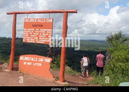Tourists at beginning of walk to Sheldrick Waterfalls in Shimba Hills National Park, Kenya, east Africa - Stock Photo