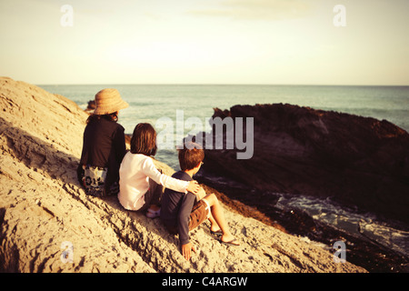 Mother, daughter and son, Cape Palliser, New Zealand. - Stock Photo
