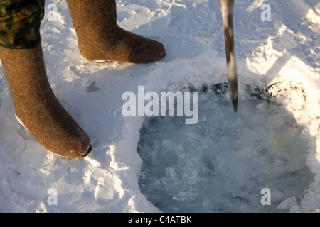 Russia, Siberia, Baikal; Undergoing preparations for fishing on frozen lake baikal in winter - Stock Photo