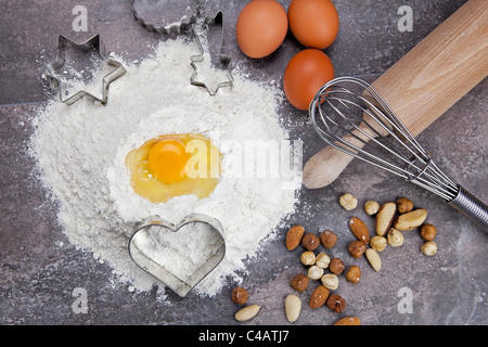 raw ingredients for preparing a dough for cookies - Stock Photo