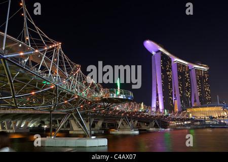Singapore, Singapore, Marina Bay.  The Helix Bridge and Marina Bay Sands Singapore. - Stock Photo
