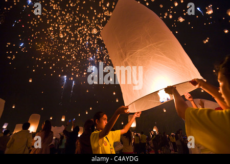 Thai people release Khom Loi, the sky lanterns during Yi Peng or Loi