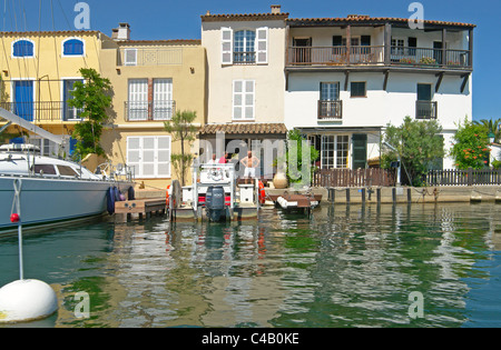 Waterside houses and boats in the resort of Port Grimaud, Var, Provence, France - Stock Photo