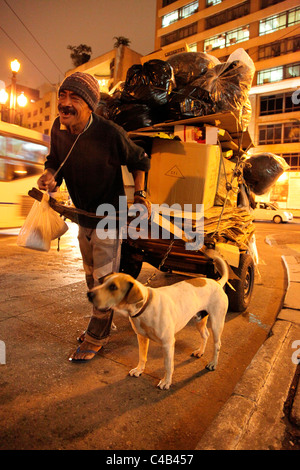 Homeless man with his dog in downtown Sao Paulo. Brazil - Stock Photo