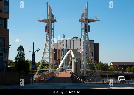 The Millennium (Lowry) footbridge and the Quay West building, Salford Quays, Manchester, UK - Stock Photo