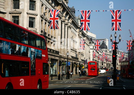 Union Jack bunting hanging in Regent Street to celebrate the wedding of Prince William and Kate Middleton, London, - Stock Photo