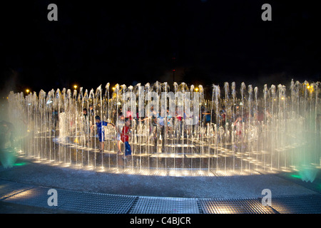 Water fountains light up at night in the Magic Circuit of Water park in Lima, Peru. - Stock Photo