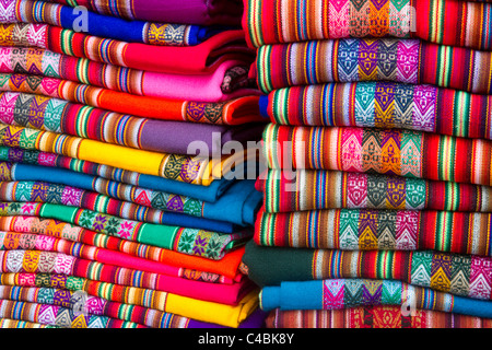 Textiles being sold at a market in Lima, Peru. - Stock Photo