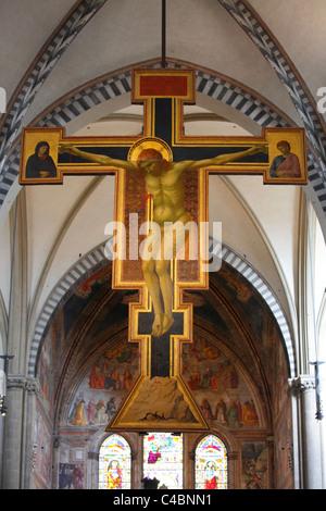 Giotto's crucifix in Santa Maria Novella, Florence, Italy - Stock Photo