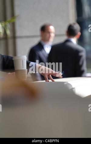 smoker taking break outside offices City of London - Stock Photo