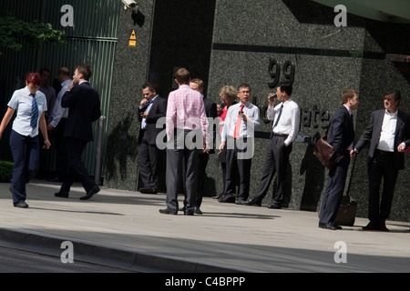 smokers taking a break outside offices central london - Stock Photo