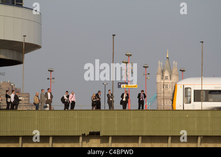 london commuters on Cannon Street station Railway Bridge originally named Alexandra Bridge, with tower bridge in - Stock Photo