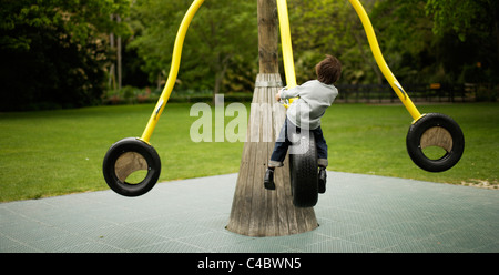 Six year old boy plays in the park - Stock Photo