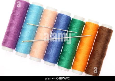 Needle and thread isolated on white background - Stock Photo