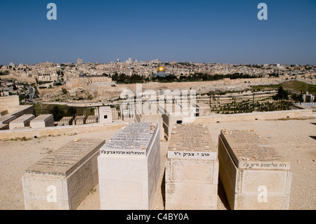 A view of the Temple mount and the old city of Jerusalem as seen from the Jewish cemetery on Mount of olives. - Stock Photo