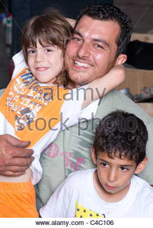 Proud and happy Greek man with daughter and son - Stock Photo