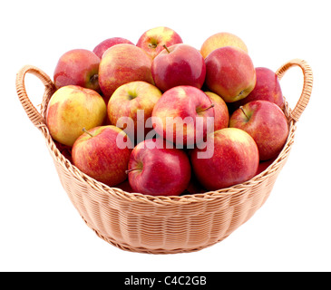 Wicker basket full of apples isolated on white - Stock Photo