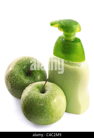 Green apple and liquid soap with water drops isolated on white - Stock Photo