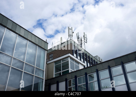 office building with mobile phone masts on the roof - Stock Photo
