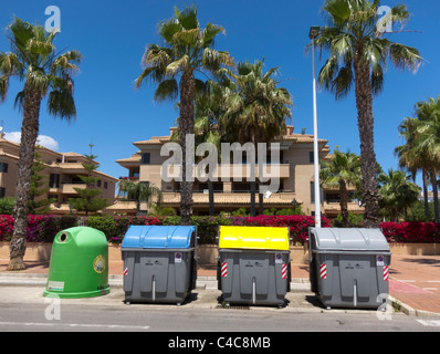 A row of rubbish bins in front of a house in a residential area of Javea, Spain. - Stock Photo