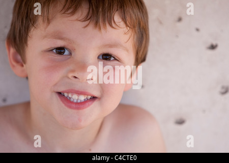 5-year-old Mexican-American boy smiles while posing at park in Austin Texas - Stock Photo