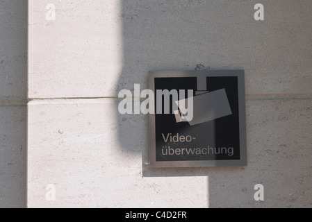 Video surveillance camera sign, in German, with image of a video camera, on a building in Munich, Germany - Stock Photo