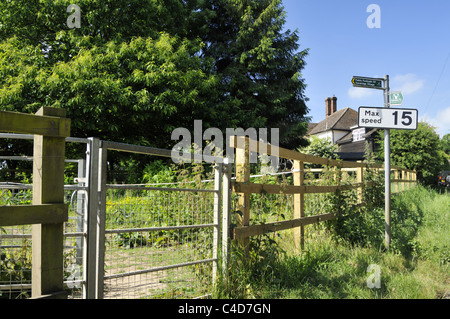 A metal kissing gate on the footpath to Sandridge village in Hertfordshire, England, UK. - Stock Photo